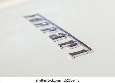 MODENA, ITALY - APRIL 2015: Museum Enzo Ferrari Modena. White Ferrari California 2008. Ferrari logo.