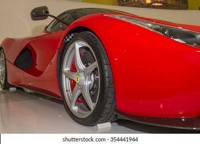 MODENA, ITALY - APRIL 2015: Museum  Enzo Ferrari Modena. Red Ferrari  La Ferrari 2013 with The Cavallino Rampante, symbol of Ferrari on. Side view. Front wheel.