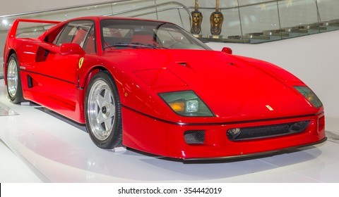 MODENA, ITALY - APRIL 2015: Museum  Enzo Ferrari Modena. Red Ferrari F40 1987 with The Cavallino Rampante, symbol of Ferrari on. Side view.