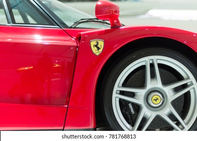 Modena, Italy - December 9, 2017: Enzo Ferrari museum, Modena. Closeup on front rim and Ferrari Logo