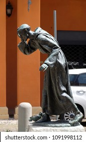 MODENA, ITALY - JUNE 04: Bronze statue of Saint Francis of Assisi, in front of St. Francis Church in Modena, Italy on June 04, 2017.