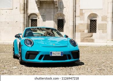 MODENA, ITALY - June, 2018. A Miami blue Porsche 911 GT3 in the Piazza Grande square
