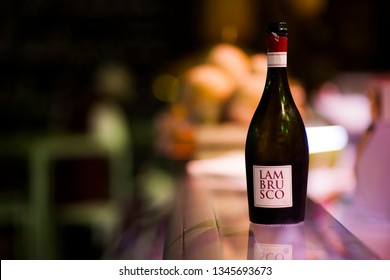Modena, Italy - May 15 2005: A bottle of  Lambrusco, very popular italian wine, produced in Emilia Romagna and Lombardy. Blurred background.