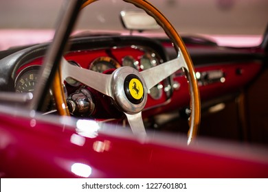 Modena, Italy - October 04 2018: Close-up of the Steering Wheel with Company Logo of a classic, red  Ferrari Car