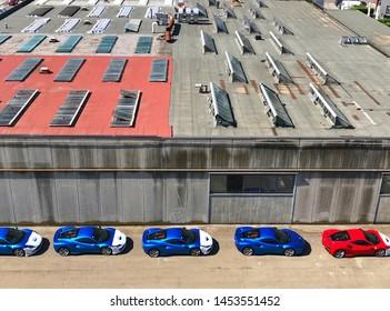 Modena, July 2019. Five beautiful brand new Ferrari F8 Tributo in color Rosso Corsa and Blu Corsa.