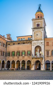 MODENA,ITALY - SEPTEMBER 25,2018 - View at the Clock tower of City hall  in Modena. Modena is also known in culinary circles for its production of balsamic vinegar.