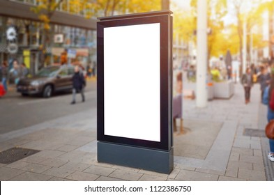 Moder city street vertical billboard mockup. People and cars in background.
