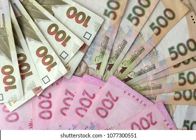 Moder Ukrainian Money backgrounds. Three funs of different value denomination - 500, 200, 100 banknotes. Hryvnia (UAH)