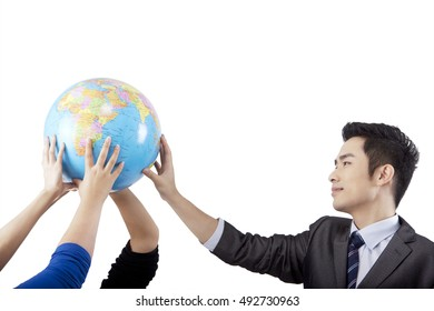 A moderate amount of crowd together holding a globe
