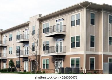 Modern 3 story apartment or condominium building in a suburban location.
