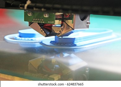 Modern 3D printer printing figure close-up macro.Automatic three dimensional 3d printer performs plastic blue colors modeling in laboratory.