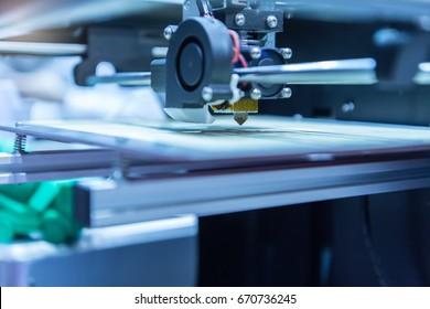 Modern 3D printer printing figure close-up macro