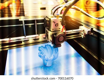 Modern 3D printer printing figure close-up macro