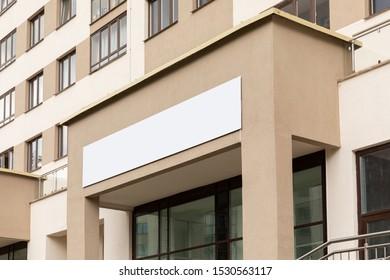 Modern accomodation unit facade with copyspace beyond front door, entry door or wide window