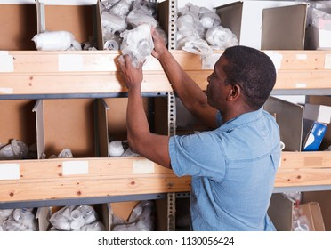 Modern African American looking for construction supplies for renovation works in building hypermarket
