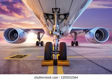 modern aircraft on an airfield against a sunset
