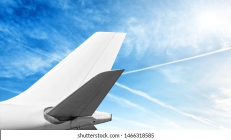 modern airplane tail isolated on cloud sky background side view of commercial passenger jet aircraft with wide body cargo plane parts like white fuselage fin wing air travel copy space template
