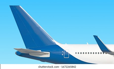 modern airplane tail side view isolated on blue sky background Passenger jet plane fuselage part Commercial aircraft blank blue fin paint scheme Luxury business jet aft body Aviation design reference