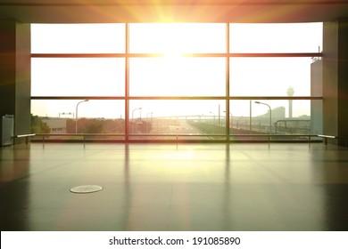 Modern airport interior glass wall aisle window