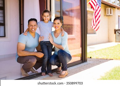 modern american family with USA flag on background