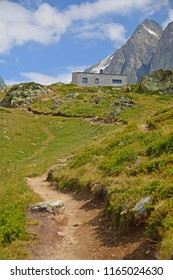 The modern Annenhutte mountain refuge at the head of the Lotschtal in the Swiss Bernese Alps. the Sattelhorn on the right