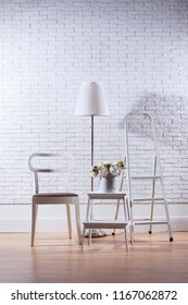 Modern apartaments decor in front of white brick wall, mockup concept