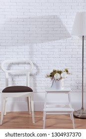 Modern apartaments decor in front of white brick wall