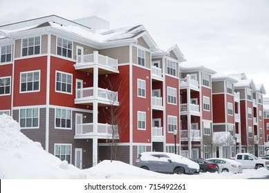 modern apartment building after winter snow storm