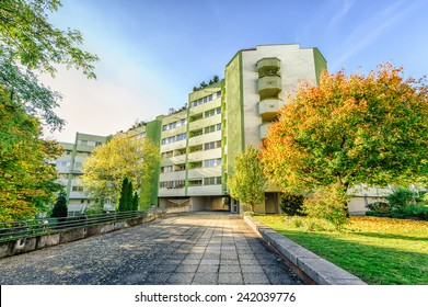 Modern apartment building with autumn colored trees