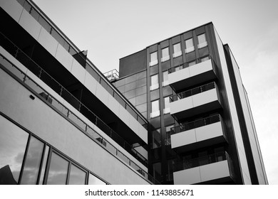 Modern apartment building exterior. Black and white.