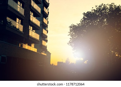 Modern apartment building exteriors during sunset