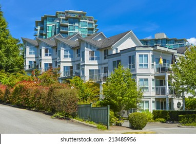 Modern apartment building on sunny day. Residential apartment building in Vancouver, British Columbia.