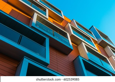 modern apartment building with red facade