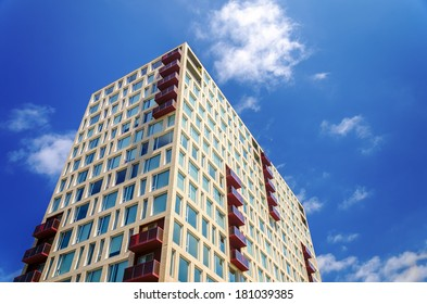 Modern apartment building rising against a beautiful blue sky in Portland, Oregon