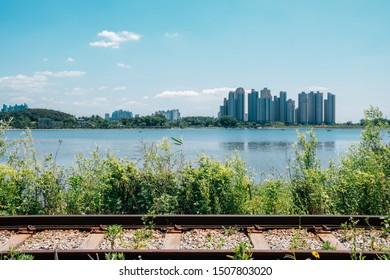 Modern apartment buildings and rail bike road at Wangsong Lake park in Uiwang, Korea