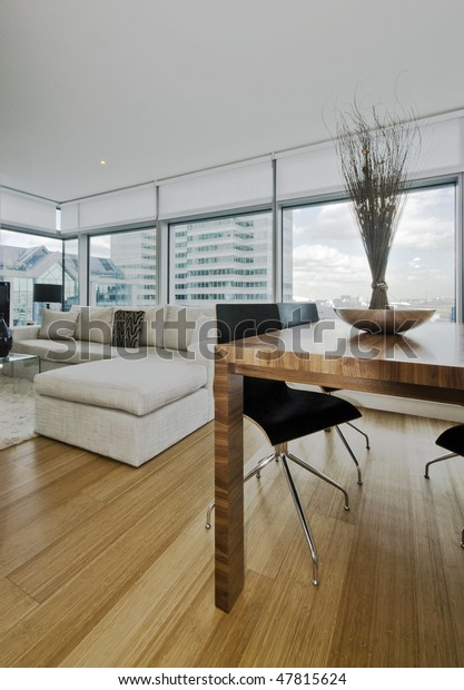 modern apartment with floor to ceiling windows and city views