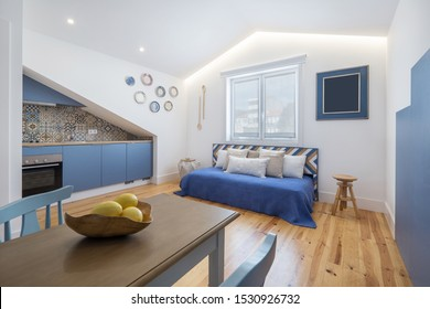 Modern apartment interior design in blue colours,  small and cozy bed room, yellow lemons on the table