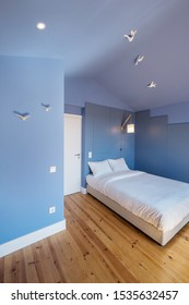 Modern apartment interior design in blue colours,  small and cozy bed room