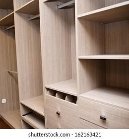 Modern apartment interior with empty wardrobe.