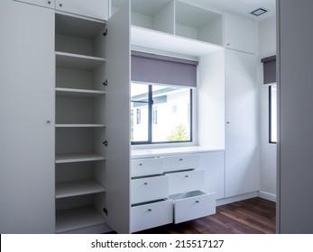 Modern apartment interior with walk in wardrobe