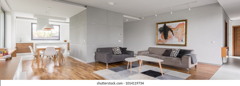 Modern apartment with open living room, kitchenette and dining area, panorama