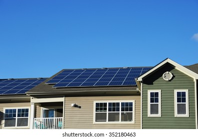 modern apartment and solar panels installed on roof
