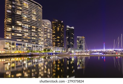 Modern apartments and a spectacular marina in Docklands in Melbourne, Australia at night