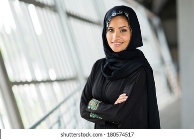 modern arabic woman with arms folded