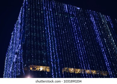 A modern architectural building is decorated with beautiful blue lighting stock photograph