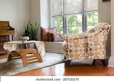 Modern Architectural Home Den Guest Room Interior Design with Elegant Chair, Table, Pillows, Plant and Piano.