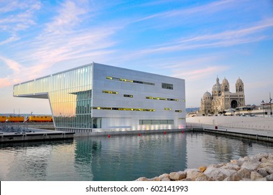 modern architecture against the background of a classical Catholic cathedral