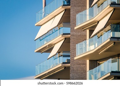 Modern architecture building facade with curtains, awnings, balcony, glass, windows