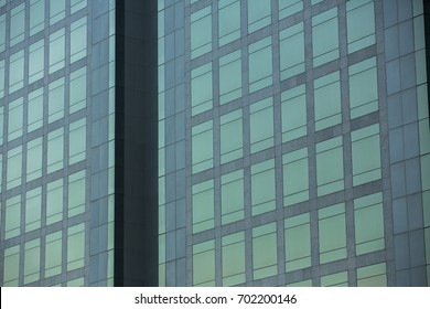 Modern architecture close up with mirror window reflection. Bangkok Thailand