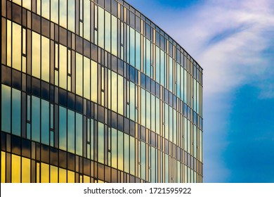 Modern architecture facade. Curtain wall facade of blue and yellow.